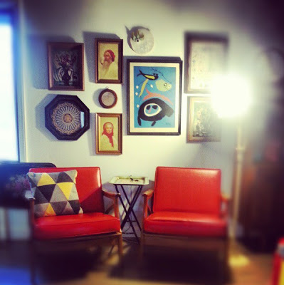gallery wall with vintage art